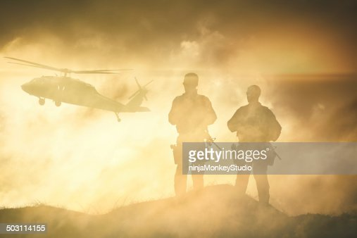 Soldiers wait for a Helicopter in Dust Storm