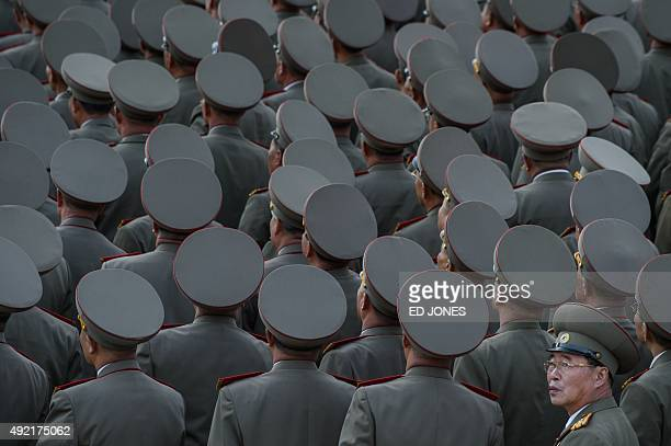 Soldiers wait for the arrival North Korean leader Kim JongUn during a mass military parade at Kim IlSung square in Pyongyang on October 10 2015 North...