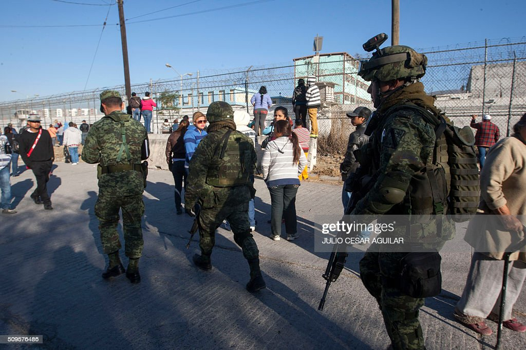 Soldiers walk outside the Topo Chico prison in the northern city of Monterrey in Mexico where according to Nuevo Leon State governor at least 52 people died and 12 were injured in a prison riot on February 11, 2016. At least 52 inmates died in a Mexican prison on Thursday as prisoners ignited a fire during a brawl between two rival groups, authorities said. Governor Jaime Rodriguez said the clash erupted at the Topo Chico prison in the northern industrial city of Monterrey before midnight on Wednesday and that authorities brought it under control at 1:30 am on Thursday. AFP PHOTO / JULIO CESAR AGUILAR / AFP / Julio Cesar Aguilar