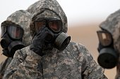 Soldiers wear mask sas they take part in a military exercise simulating a chemical weapons attack during the international Eager Lion military event...