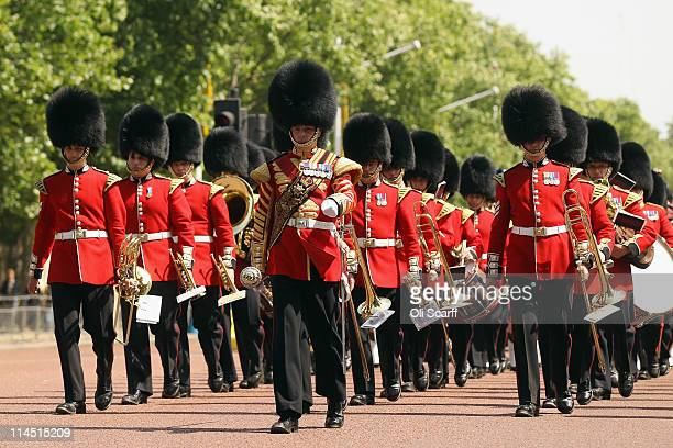Soldiers wearing bearskins march along the Mall ahead of the visit by US President Barack Obama on May 23 2011 in London England Mr Obama is...