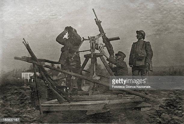 Soldiers with antiaircraft machine gun mod 1907F the artillerymen searching the sky with binoculars Photography Italy Castel Grimaldo March 1918