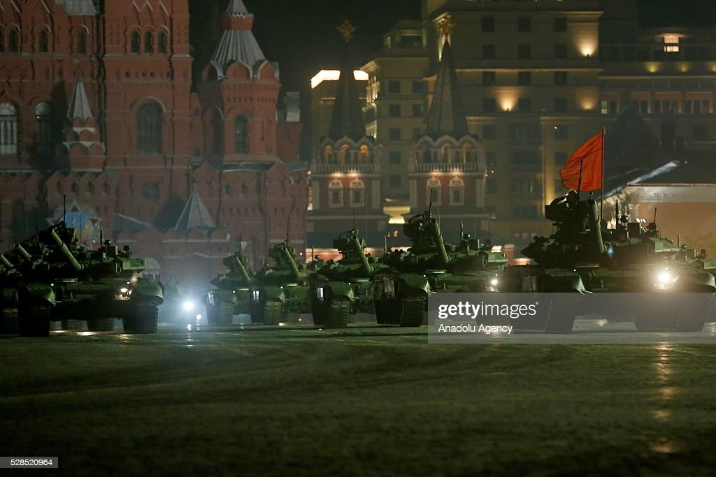 Soldiers with armored military vehicles are seen during the rehearsal of a military parade which will be held within the celebrations for the 9th of May Victory Day in Moscow, Russia on May 5, 2016.