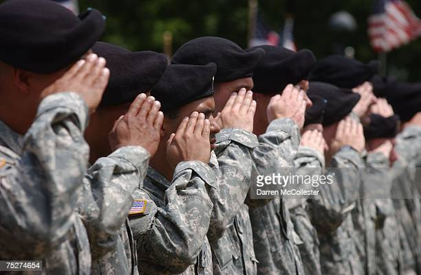Soldiers with C Company First Battalion of the 181st Infantry Regiment of the Massachusetts National Guard stand at attention during a deployment...