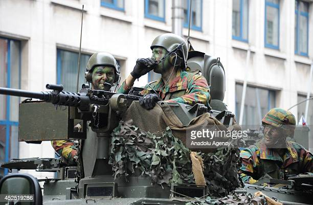 Soldiers with camouflage patterned cloths are seen as Belgium military units attend the parade as part of ceremonies marking Belgium's National Day...