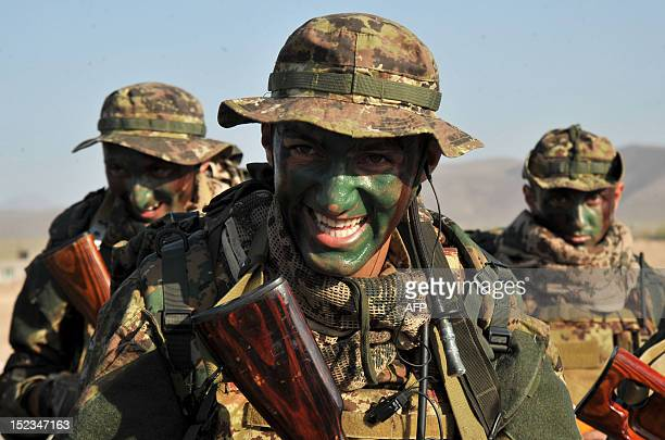 Soldiers with painted faces march during a military exercise at the Marshal Bagramian training grounds near the ArmeniaTurkey border in Armenia on...