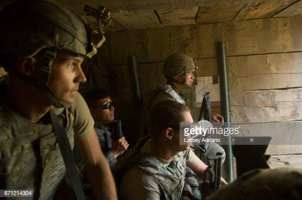 Soldiers with the 173rd division and Afghan workers on the base hide in a bunker at the KOP forward operating base as the Taliban fires mortars at...