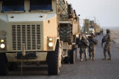 Soldiers with the 3rd Brigade Combat Team 1st Cavalry Division perform a security check on their Mine Resistant Ambush Protected vehicles near the...