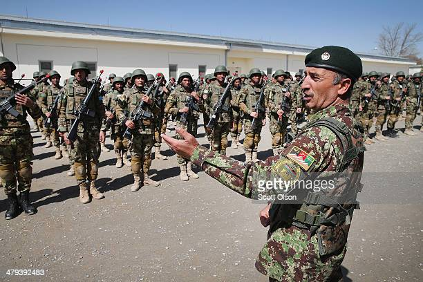 Soldiers with the Afghan National Army graduate from basic training during a ceremony at the ANA's Combined Fielding Center on March 18 2014 in Kabul...