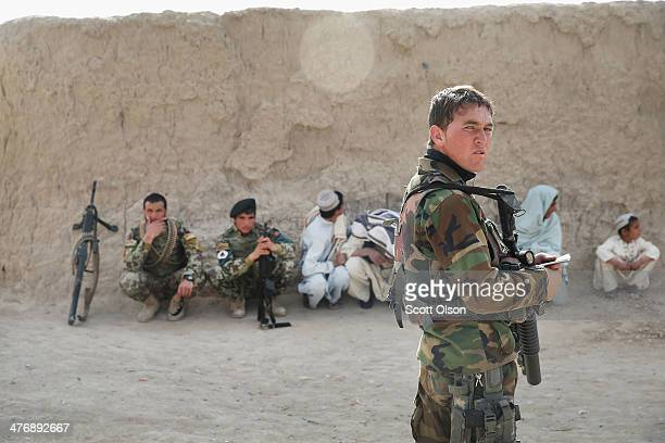Soldiers with the Afghan National Army patrol through a village March 5 2014 near Kandahar Afghanistan President Obama recently ordered the Pentagon...