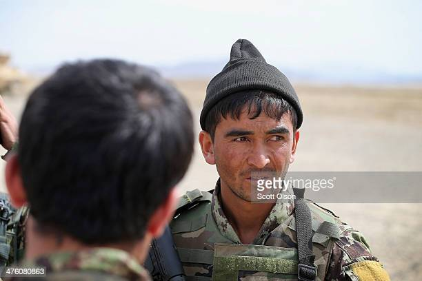 Soldiers with the Afghan National Army prepare to patrol through a village with soldiers with the US Army's 4th squadron 2d Cavalry Regiment on March...