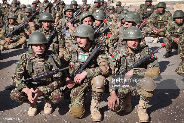 Soldiers with the Afghan National Army wait for the start of their basic training graduation ceremony at the ANA's Combined Fielding Center on March...