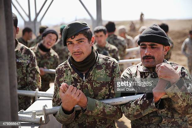 Soldiers with the Afghan National Army's National Engineer Brigade learn how to construct a MabeyJohnson portable prefabricated bridge with the help...