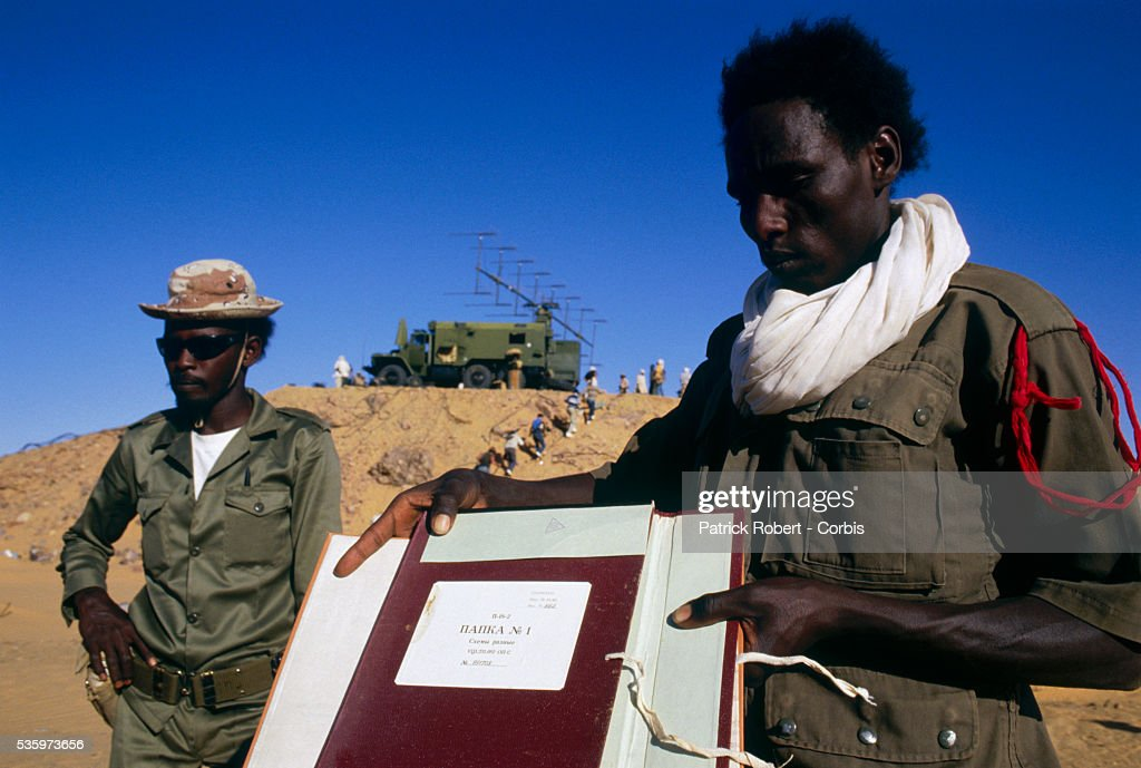 Soldiers with the Forces Armees Nationales Chadiennes (FANT), or National Army of Chad, display Libyan propaganda documents written in Russian seized during military operations in Wadi Doum. Their mission in early 1987 was to reconquer the Borkou-Ennedi-Tibesti Prefecture and recover the territory in northern Chad that had been under Libyan control.