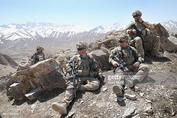 Soldiers with the US Army's 2nd Battalion 87th Infantry Regiment 3rd Brigade Combat Team 10th Mountain Division rest along a ridgeline following a...