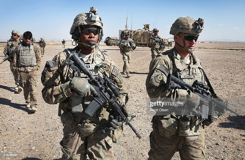 Soldiers with the US Army's 4th squadron 2d Cavalry Regiment patrol through a village on February 27 2014 near Kandahar Afghanistan Defense Secretary...