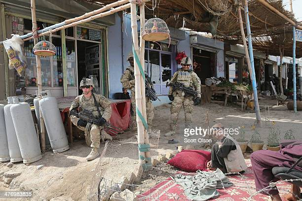 Soldiers with the US Army's 4th squadron 2d Cavalry Regiment patrol through a market on March 5 2014 near Kandahar Afghanistan President Obama...