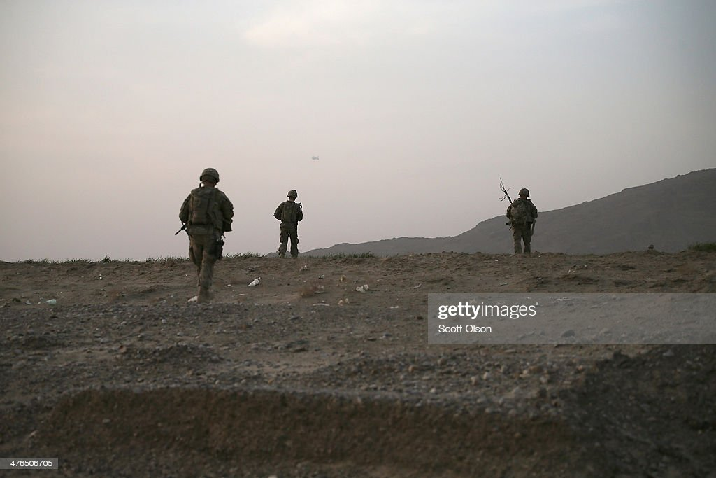 Soldiers with the U.S. Army's 4th squadron 2nd Cavalry Regiment patrol through open fields toward a village on March 3, 2014 near Kandahar, Afghanistan. President Obama recently ordered the Pentagon to begin contingency planning for a pullout from Afghanistan by the end of 2014 if Afghanistan President Hamid Karzai or his successor refuses to sign the Bilateral Security Agreement.