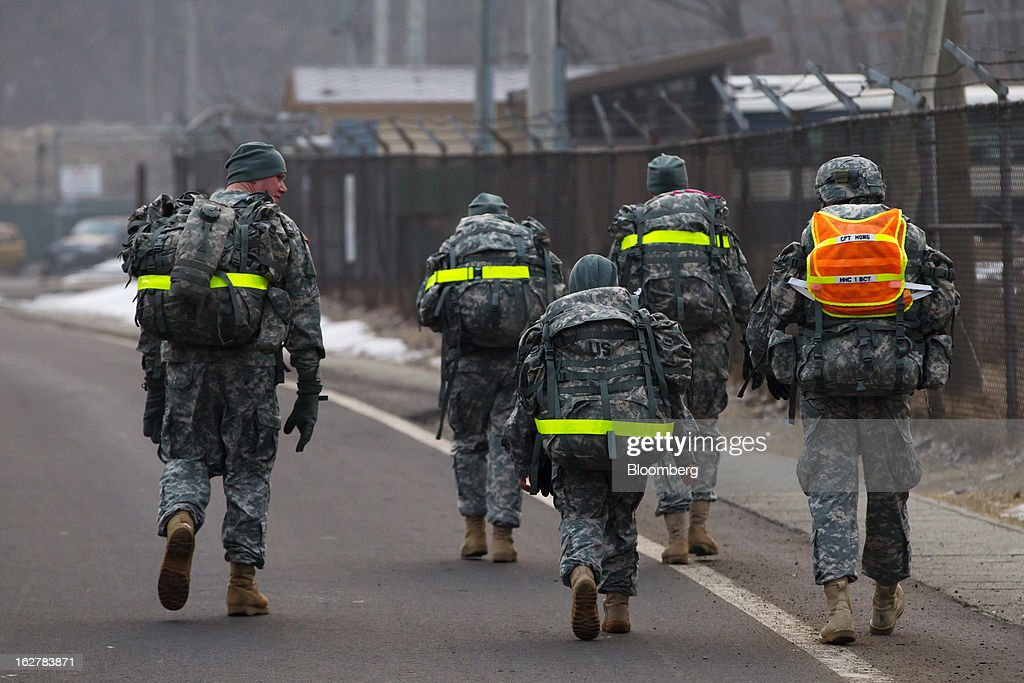 Soldiers with the U.S. Army's Second Infantry Division carry backpacks as they walk through Camp Casey in Dongducheon, South Korea, on Tuesday, Feb. 26, 2013. The U.S. has 28,500 soldiers in South Korea as a legacy of the 1950-53 Korean War, which ended in a cease-fire that left the two Koreas technically still at war. Photographer: SeongJoon Cho/Bloomberg via Getty Images
