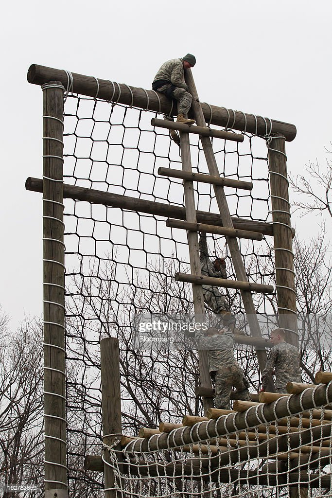 Soldiers with the U.S. Army's Second Infantry Division negotiate obstacles during an air assault training course at Camp Casey in Dongducheon, South Korea, on Tuesday, Feb. 26, 2013. The U.S. has 28,500 soldiers in South Korea as a legacy of the 1950-53 Korean War, which ended in a cease-fire that left the two Koreas technically still at war. Photographer: SeongJoon Cho/Bloomberg via Getty Images