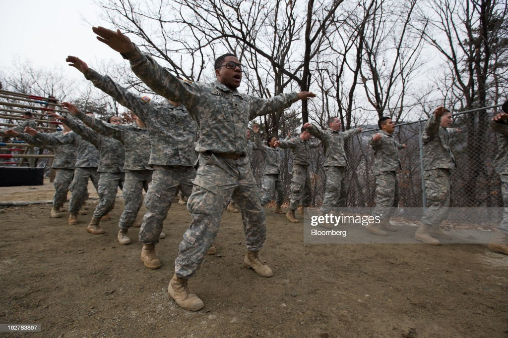Soldiers with the U.S. Army's Second Infantry Division perform exercises during an air assault training course at Camp Casey in Dongducheon, South Korea, on Tuesday, Feb. 26, 2013. The U.S. has 28,500 soldiers in South Korea as a legacy of the 1950-53 Korean War, which ended in a cease-fire that left the two Koreas technically still at war. Photographer: SeongJoon Cho/Bloomberg via Getty Images