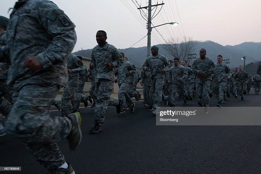Soldiers with the U.S. Army's Second Infantry Division run during an air assault training course at Camp Casey in Dongducheon, South Korea, on Tuesday, Feb. 26, 2013. The U.S. has 28,500 soldiers in South Korea as a legacy of the 1950-53 Korean War, which ended in a cease-fire that left the two Koreas technically still at war. Photographer: SeongJoon Cho/Bloomberg via Getty Images