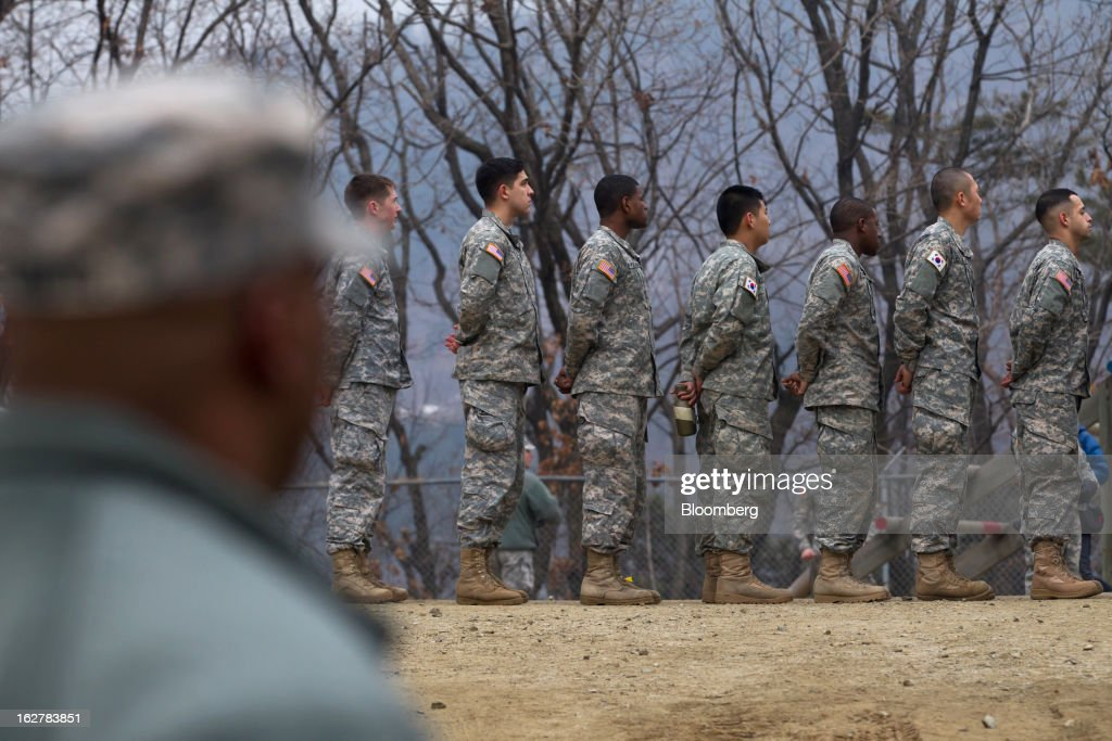Soldiers with the U.S. Army's Second Infantry Division stand in a line during an air assault training course at Camp Casey in Dongducheon, South Korea, on Tuesday, Feb. 26, 2013. The U.S. has 28,500 soldiers in South Korea as a legacy of the 1950-53 Korean War, which ended in a cease-fire that left the two Koreas technically still at war. Photographer: SeongJoon Cho/Bloomberg via Getty Images