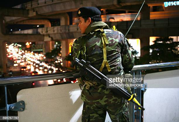Soldiers with their weapons were stationed overlooking Siam Square the heart of the commercial and shopping district of Bangkok after the military...