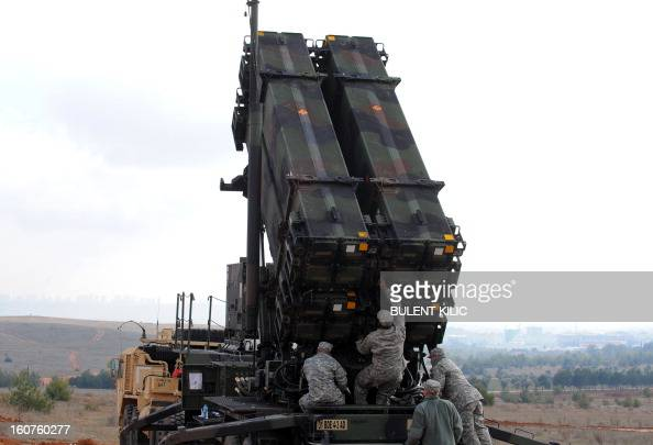 US soldiers work on a Patriot missile system at a Turkish military base in Gaziantep on February 5 2013 The United States Germany and the Netherlands...