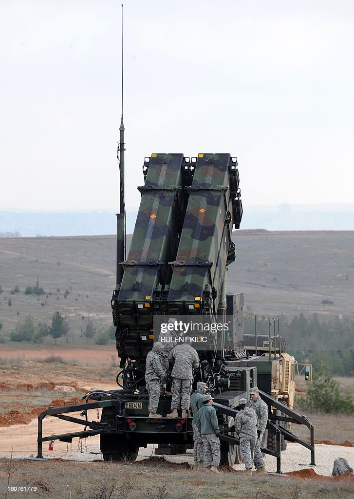 US soldiers work on a Patriot missile system at a Turkish military base in Gaziantep on February 5, 2013. The United States, Germany and the Netherlands committed to send two missile batteries each and up to 400 soldiers to operate them after Ankara asked for help to bolster its air defences against possible missile attack from Syria. AFP PHOTO / BULENT KILIC