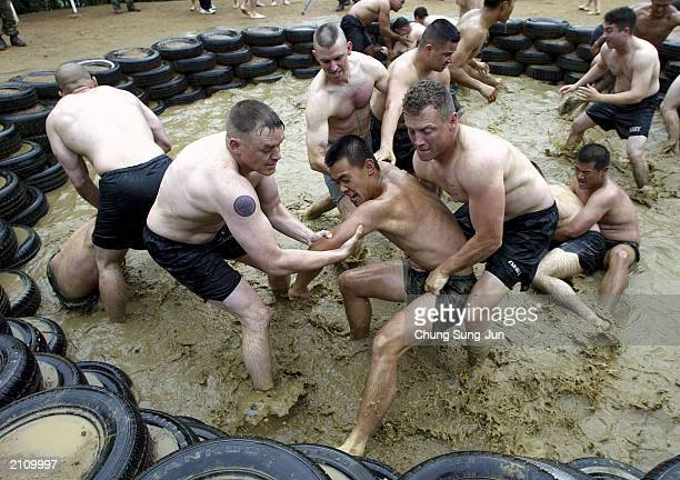 S soldiers wrestle with South Korean soldiers in a muddy ring during a joint ranger training exercise at a ranger camp near the demilitarised zone...