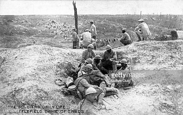 Soldiers's daily life during World War 1 A battlefield game of cards Official photograph of 'La Section Photographique de l'Armée Française'