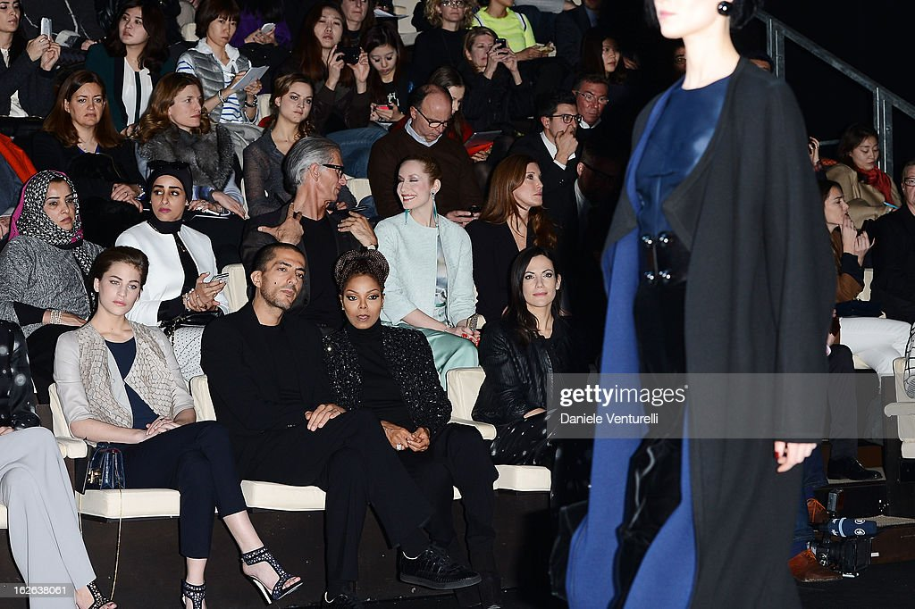 Solene Hebert, Wissam al Mana and Janet Jackson attend the Giorgio Armani fashion show during Milan Fashion Week Womenswear Fall/Winter 2013/14 on February 25, 2013 in Milan, Italy.