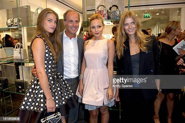 Solene Hebert Xavier Romatet Beatrice Rosen and Malgosia Bela attend Vogue Fashion Night Out 2012 on September 6 2012 in Paris France