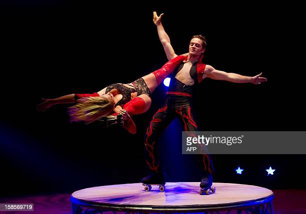 Solenn and Jonathan Pilar perform during the final rehearsal for the Wereldkerstcircus at the Carre Theater in Amsterdam on December 19 2012...