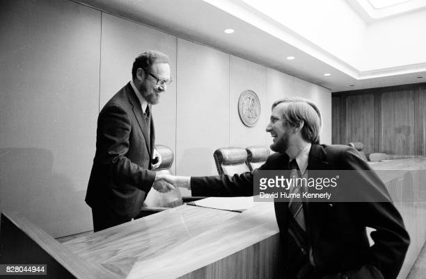 Solicitor General of the United States and acting US Attorney General Robert Bork shakes hands with an unidentified man at a press conference on...