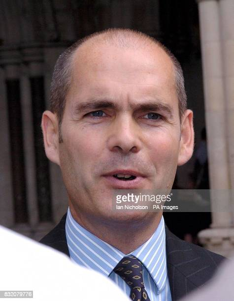 Solicitor Jonathan Coad speaks to media outside the High Court London after hypnotist Paul McKenna won his libel action over a claim that he bought a...