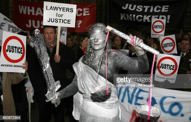 Solicitor Sally Middleton dressed as Lady Justice outside Parliament in London with other lawyers who are protesting in a 'desperate attempt to save...