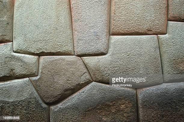 無地の彫刻を施した石の壁の背景サクサイワマンクスコペルー