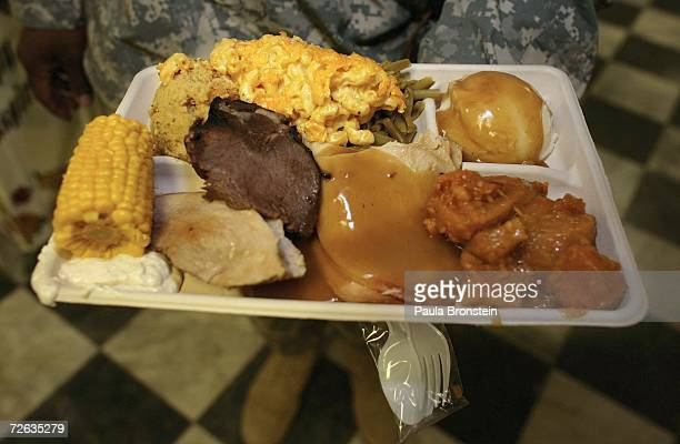 A solider displays his huge plate of food as the US military get served a special Thanksgiving meal at the Bagram military base in Bagram Afghanistan...