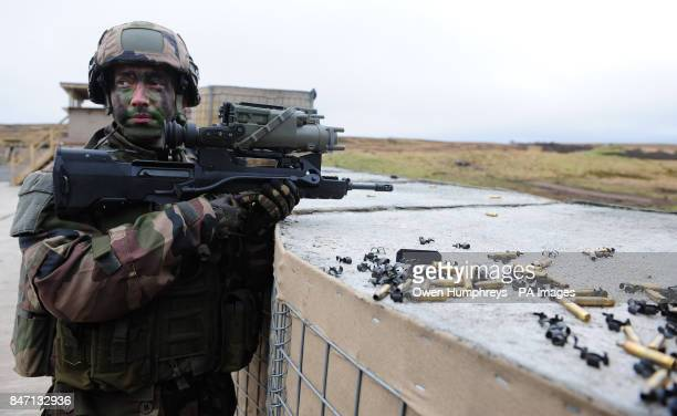 A solider of the French Army Parachute Company from the French 11th Parachute Brigade taking part in Boars Head a joint live firing exercise with...