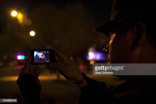 A solider shows pictures he has taken at the murder scene in the city of Juarez The violence generated by the war of the drug cartels for control of...
