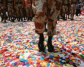Solider walking in confetti after parade