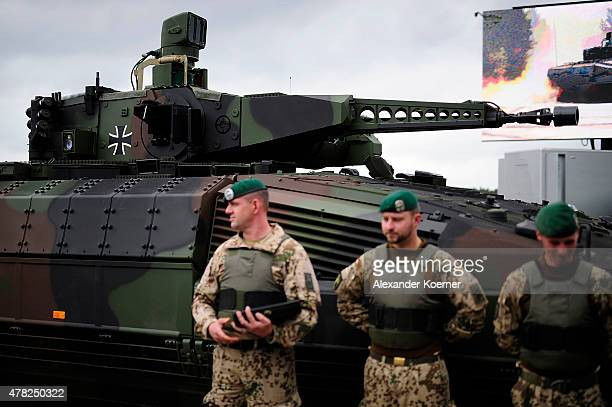 Soliders and crew members of the German Armed stand next to the new Puma Light Tank at the official handover ceremony of the tank to the German armed...