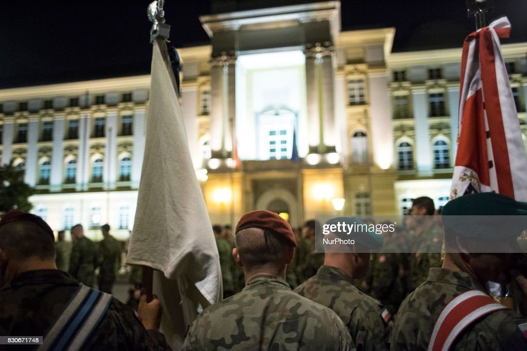 Soliders stay near polish government building during night training before parade on Polish Army Day in Warsaw on August 12, 2017.