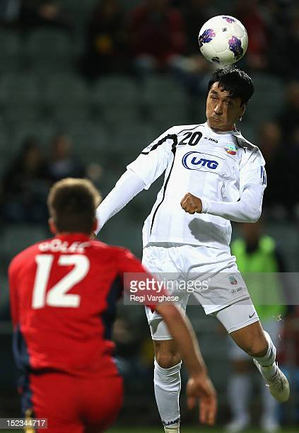 Soliev Anvarjon of Bunyodkor heads the ball during the AFC Champions League Quarter Final match between Adelaide United and Bunyodkor at Hindmarsh...
