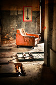 Solitary Armchair in Ruined Rotten Building