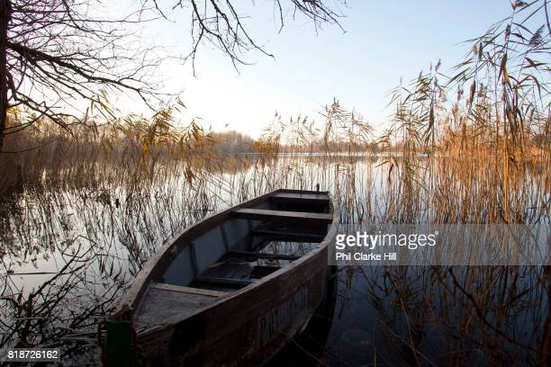 A solitary boat in Uckermarkische Seen Natural park part of the The Feldberg Lake District Nature Park containing large lakes kettle bogs and an...
