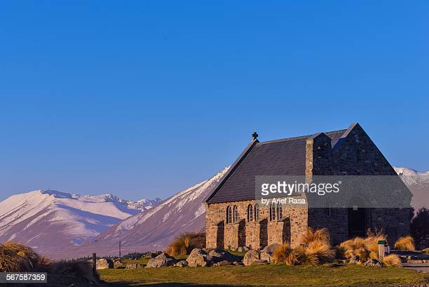 Solitary church with mountain background
