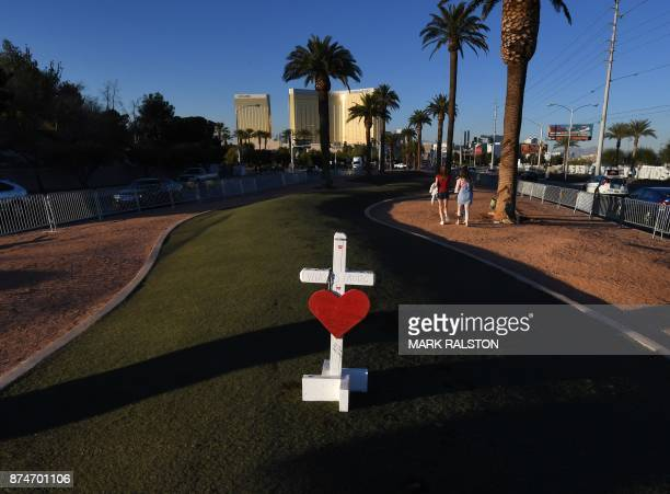 TOPSHOT A solitary cross remains at a memorial site in front of the Mandalay Hotel for the 58 victims of the worst shooting in US history at Las...